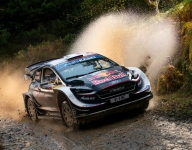 Ogier takes command of Rally GB after Tanak retires