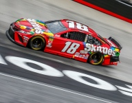 Kyle Busch holds off his older brother for the win at Bristol