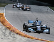 Rosenqvist chases down O'Ward at Road America for first IndyCar win