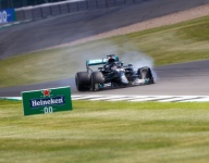 Hamilton three-wheels to British GP win