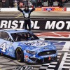 Harvick holds off Kyle Busch in Bristol nail-biter