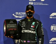 Hamilton says pressure is off as he closes on 100th pole
