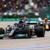 Hamilton storms to 100th Grand Prix win in Russian rain